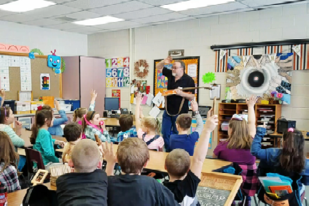 The Swamp Drivers' Terry Johnson Visits Kindergarten and 4th Grade Classes with Frying Pan Guitar Featured on Rachael Ray Show